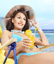 Girl in bikini drinking cocktail. Royalty Free Stock Photos