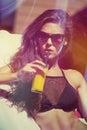 Girl in bikini enjoy in sun and juice at pool Royalty Free Stock Photo
