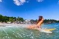 Girl in bikini has a fun on surf board Royalty Free Stock Photo