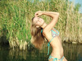 Girl in bikini pose in the water Stock Photos