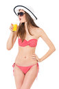 Girl in bikini pretty posing summer hat and sunglasses isolated on white background Stock Image