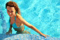 Girl in bikini stands in swimming-pool Royalty Free Stock Images
