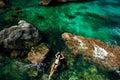 Girl in bikini swimming in the sea aerial top view teenage and relaxing blue lagoon Royalty Free Stock Photo