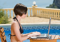 Girl in Bikini Using Laptop by the Pool Royalty Free Stock Image