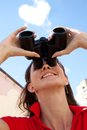 Girl with binoculars and heart cloud Stock Photos