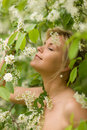 image photo : Girl with bird-cherry flowers