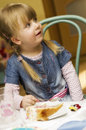 Girl with birthday cake portrait of preschool sat at table Stock Photography