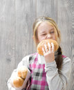 Girl bites off a bun little Royalty Free Stock Image