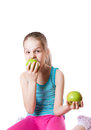 Girl biting an apple Royalty Free Stock Photo