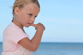 Girl biting her thumbnail young Royalty Free Stock Images