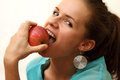 Girl biting red apple Royalty Free Stock Photos