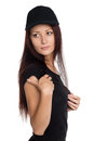 Girl in a black baseball cap looking away Royalty Free Stock Photo