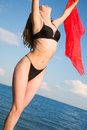 Girl in a black bathing suit Stock Image