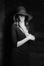 Girl in black dress and hat mysterious young woman straw wide brimmed white photo Stock Photography