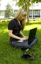 Girl in black laptop Royalty Free Stock Photos
