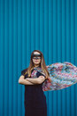 Girl in black superhero mask over blue wall Stock Image
