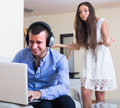 Girl blaming boyfriend in visiting date sites Royalty Free Stock Photo