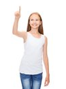 Girl in blank white shirt pointing to something design concept smiling teenage or pressing imaginary button Royalty Free Stock Photography