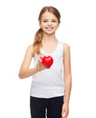 Girl in blank white shirt with small red heart design health charity love concept smiling teenage Royalty Free Stock Photography