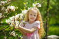 Girl with blooming magnolia Royalty Free Stock Photo
