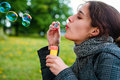 Girl blow soap bubble Stock Image