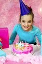 Girl blowing birthday candles out having fun at party while Stock Photography