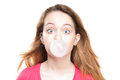 Girl blowing bubble from chewing gum Royalty Free Stock Photo
