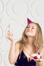 Girl blowing candles beautiful caucasian on her cake Royalty Free Stock Images