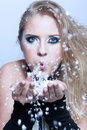 Girl blowing snow Royalty Free Stock Photos