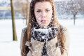 Girl blowing snow from hands winter Stock Image