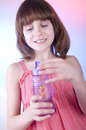 Girl blowing soap bubbles cute child Stock Image