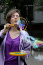 Girl blows big soap bubbles Stock Photo