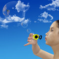 Girl blows thought bubble bubbles Royalty Free Stock Image