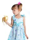 A girl in a blue dress with a banana Stock Photos
