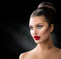 Girl with blue eyes and sexy red lips fashion model portrait Royalty Free Stock Image