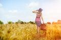 Girl in blue hat walking away in golden sunlight Royalty Free Stock Photo
