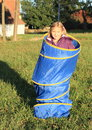 Girl in blue kids tunnel little standing for Stock Image