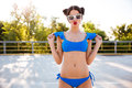 Girl in blue swimsuit posing and making funny face outdoors Royalty Free Stock Photo