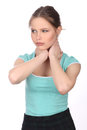 Girl in blue T-shirt touching her neck. Close up. White background Royalty Free Stock Photo
