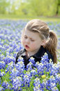 Girl in bluebonnets beautiful little sitting special needs child sitting getting sleepy Stock Image