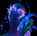 Girl with body art portrait of beautiful woman glowing in ultraviolet light Royalty Free Stock Photos