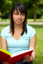 Girl with a book outdoors Stock Photo