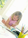 Girl with book smiling portrait low angle view tilt Royalty Free Stock Photos