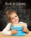 Girl with books schoolgirl in classroom back to school blackboard Stock Photos