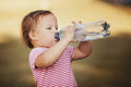 Girl with bottle of mineral water little Stock Photos