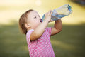 Girl with bottle of mineral water little Stock Photo