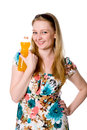 A girl with a bottle of orange juice Royalty Free Stock Photo
