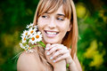 Girl with bouquet of camomiles Stock Images