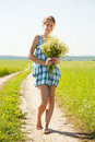 Girl with bouquet of camomiles Royalty Free Stock Photo