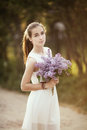 Girl with bouquet of lilac beautiful Royalty Free Stock Image
